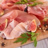 Prosiutto ham, cured ham and fig Royalty Free Stock Image