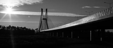 Prospect of black and white bridge in sunny day. Prospect of black and white bridge in sunny day Stock Photos