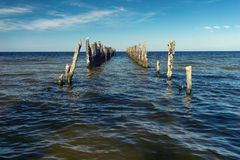 The prospect of an old pier on the horizon in the Baltic Sea Royalty Free Stock Photos