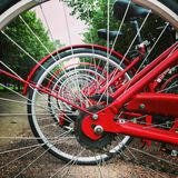 The prospect of red bicycle wheels. Royalty Free Stock Photos