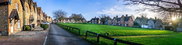 Prospect Square with workers houses built around grassy common in Westbury, Wiltshire, UK. On 17 January 2019 stock photo