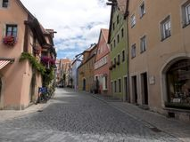 Prospect view of ancient street of medieval town Rothenburg Ob d. Er Tauber in Bavaria, Germany. Colorful pavilions with pebble flooring Stock Photos