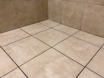 Prospective shot of the newly installed tile floor and wall tiles. Beautiful perspective shot of the newly installed luxury tiles. Close up of floor tiles stock images