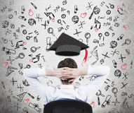 A prospective student is pondering over the advantages of education. Stock Photography