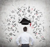 A prospective student is pondering over the advantages of education. Stock Images