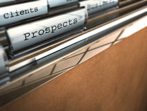 Prospects and clients. Folder with the word prospects and at the backside another one where it is written client, brown paper and clear plastic royalty free illustration