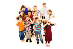 Prospects. Group of cheerful schoolchildren standing together and facing the same direction. Isolated over white stock images