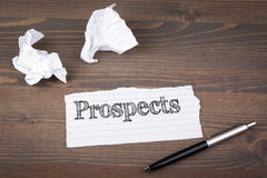 Prospects. paper sheet from the booklet on the wooden table.  Stock Photography