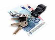 Prosperity. Keys, money and a car means prosperity, isolated royalty free stock images