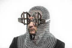 Prosperity, businessman with medieval executioner in metal and s Stock Photography