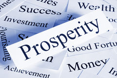 Prosperity Concept. A conceptual look at prosperity with associated words, blue toned royalty free stock photo