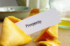 Prosperity cookie. Fortune cookie closeup with paper prosperity message stock photography