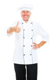 Prosperous chef showing thumbs up Royalty Free Stock Image