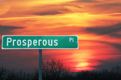 Prosperous Place Street Sign. Street sign of Prosperous Place against sunset Stock Photo