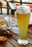 Prost. A fresh German Hefeweissbier in a beach Bistro, in final Ligure, Italy stock images