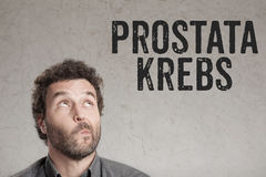 Prostata Krebs, German text for Prostate Cancer man writing on g Stock Photo