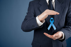 Prostate cancer awareness. Peace and genetic disorder awareness - man with protective and support gesture and blue ribbon royalty free stock photography