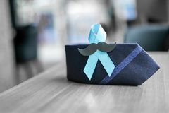Prostate Cancer Awareness. Light Blue Ribbon with mustache and necktie for supporting people living and illness. Men Healthcare and World cancer day concept stock images