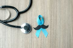 Prostate Cancer Awareness. Light Blue Ribbon with stethoscope for supporting people living and illness. Men Healthcare and World cancer day concept stock images