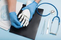 Prosthetics hands at doctor in clinic. Artificial limb stock photo