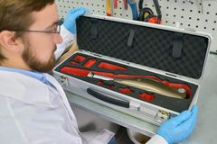 Prosthetics Technician Packing Prosthetic  Leg Stock Photos