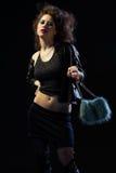 Prostitute. Portrait of girl dressed like hooker posing on black Stock Photo