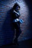 Prostitute. Portrait of girl dressed like hooker posing near brick wall Stock Photos