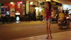 Prostitute waiting for costumer on street at night Stock Image