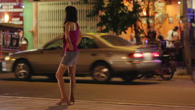 Prostitute waiting for costumer on street at night Stock Photography