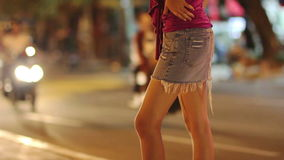 Prostitute waiting for costumer on street at night Royalty Free Stock Photography