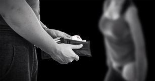 Prostitution. Paying prostitute with money from wallet, black and white with copy space Royalty Free Stock Images