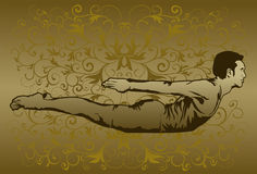 A Prostrate Yoga Posture. An image of a man lying prostrate on the ground while elevating his head and legs as he is performing a yoga exercise Stock Image