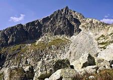 Prostredny hrot peak in Vysoke Tatry mountains. Prostredny hrot peak from Mala Studena dolina valley in Vysoke Tatry mountains with blue sky stock photography