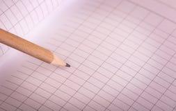 Prosty drewniany ołówek i notepad Zdjęcia Stock