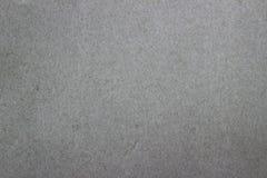 Prosty papier jest szarym tłem Zdjęcie Stock