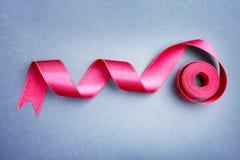 Prosty różowy faborek na koloru tle Obraz Stock