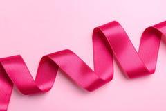 Prosty różowy faborek na koloru tle Zdjęcie Stock
