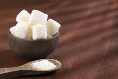 Proszek i sześciany dystyngowany cukier obrazy royalty free