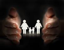 Protégez la famille Photos stock
