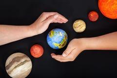 Protégez la terre - notre maison Image stock