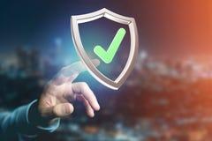Protégez le symbole montré sur une interface futuriste - le rendu 3d Photographie stock libre de droits