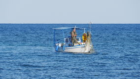 Protaras, Cyprus - February 3, 2016: Fisherman swims on his fishing boat in the sea stock footage