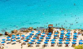 PROTARAS, CYPRUS, Konnos Beach. PROTARAS, CYPRUS - August 18 2016: view of Konnos Beach with sunbathers Stock Photo