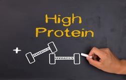 Proteína y levantamiento de pesas Fotografía de archivo