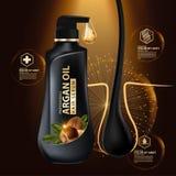 Protección del cuidado del cabello del aceite del Argan contenida en botella Fotos de archivo