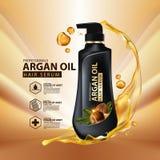 Protección del cuidado del cabello del aceite del Argan contenida en botella Foto de archivo libre de regalías