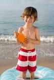 Protección solar del espray del whithLotion del niño Foto de archivo libre de regalías