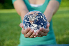 Protect the Earth. A hand holding a globe, saving environment recycle Royalty Free Stock Photos