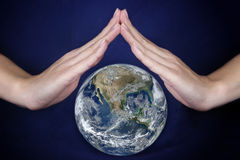 Protect the Earth. Elements of this image furnished by NASA Stock Photos
