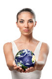 Protect the earth and environment. Beautiful woman holding planet earth with care and responsibility, symbol of nature and environment protection Stock Images